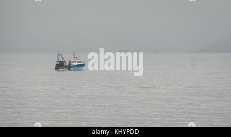 Portobello, Edinburgh, Scotland, United Kingdom, 21st November 2017.  A fishing boat close to the coastline seen - Stock Photo