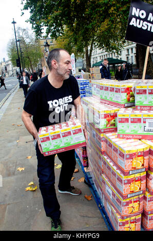 London, UK. 21st Nov, 2017. End austerity food bank demonstration outside Downing street. Protest as Mrs May possible - Stock Photo
