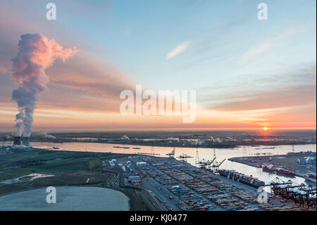 View on nuclear plant of Doel and Deurganck Terminal and MSC - Stock Photo