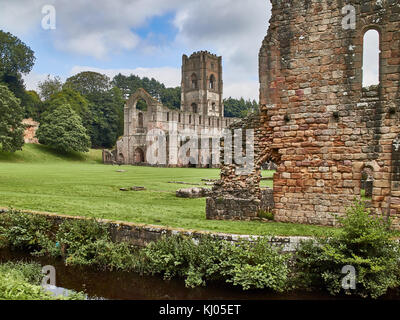 England, NorthYorkshire; the ruins of the 12th century Cistercian Abbey known as Fountains Abbey, one of the finest - Stock Photo