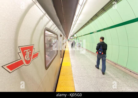 Toronto, Canada - Oct 13, 2017: Train arriving at the platform of a subway station in the city of Toronto, Canada - Stock Photo