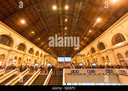 BUDAPEST, HUNGARY - DECEMBER 1, 2014: Passengers on the stairs of main building of Keleti station in Budapest, Hungary - Stock Photo