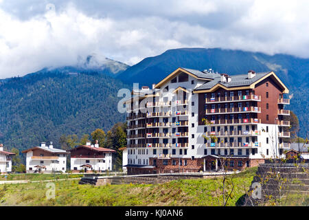 Panorama of Russian resort Roza Hutori international hotel in summer sunny day - Stock Photo