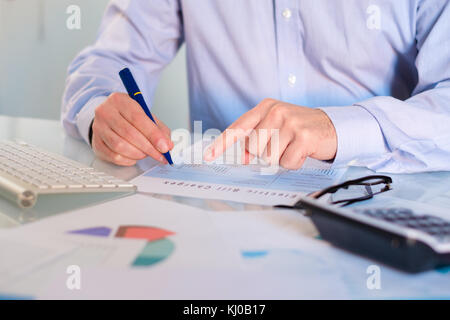 Hand man doing finances and accounting about cost at home office.Concept finances and economy - Stock Photo
