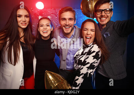 new year party, holidays, celebration, nightlife and people concept - Young people having fun dancing at a party - Stock Photo