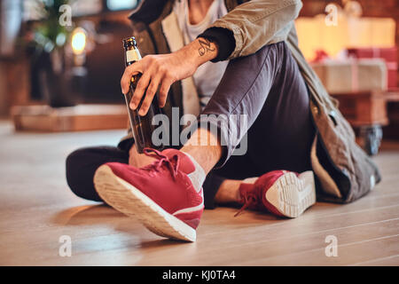 A man drinks beer. - Stock Photo