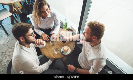 Young business people having a coffee break - Stock Photo