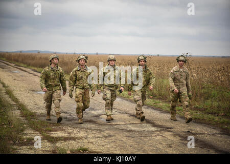 KOVIN, Serbia -- Paratroopers from Able Co. 2nd Bn., 503rd Infantry Regiment, 173rd Airborne Brigade return to the - Stock Photo