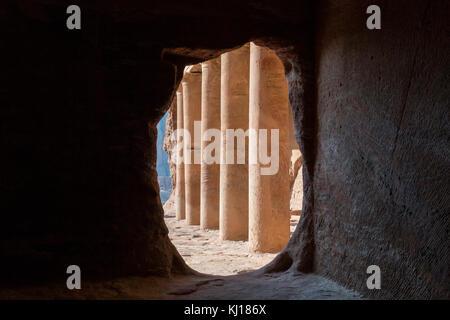 Pillars inside the Royal Tombs in the ancient city of Petra, Jordan - Stock Photo