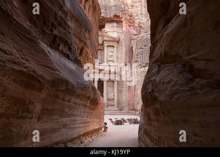 View from Siq on entrance of City of Petra, Khazneh in the background, Jordan - Stock Photo