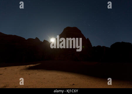 Wadi Rum at night during full moon, Jordan - Stock Photo