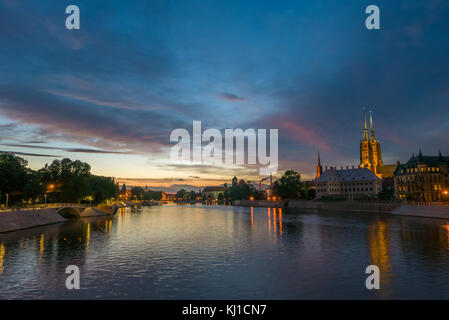 Majestic vivid sky over the river and old town in Wrocław, Poland - Stock Photo