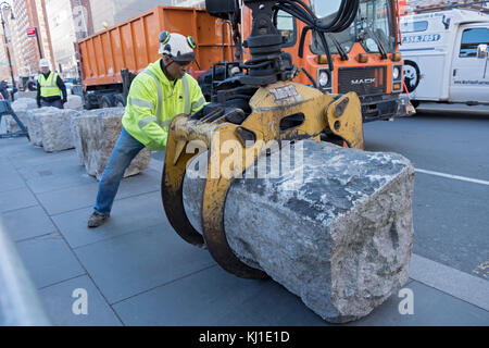 A New York City Parks department worker helps install anti-terror blockades at hte south end of Union Square Park - Stock Photo