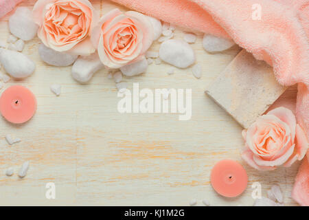 Spa settings with roses. Various items used in spa treatments on white wooden background. - Stock Photo