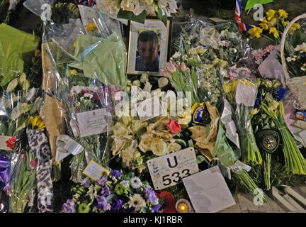 Flowers and tributes decorate a portrait of the murdered Police officer, PC Keith Palmer,, at Parliament green opposite - Stock Photo