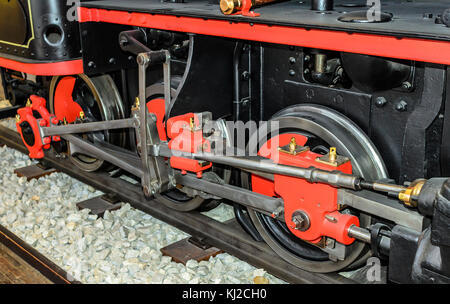 Locomotive wheels are close-up. Part of an old steam locomotive. - Stock Photo