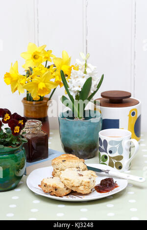 Afternoon tea with scones in a sunny spring home - Stock Photo