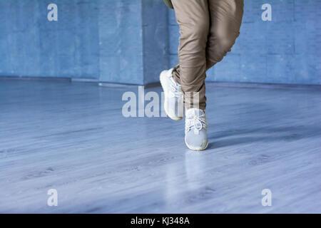 Hip-hop dancer im movement, cropped image. - Stock Photo