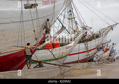 Wooden pinisis / phinisis, traditional Indonesian two-masted sailing ships at Sunda Kelapa / Sunda Kalapa, old Batavia - Stock Photo