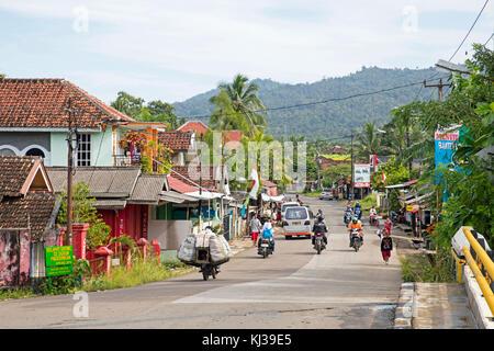 Street scene showing motorbikes in the coastal town Carita, Pandeglang Regency, Banten Province, West Java, Indonesia - Stock Photo