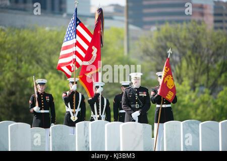 U.S. Marines from Marine Barracks Washington (8th and I) participate in the graveside service at Arlington National - Stock Photo