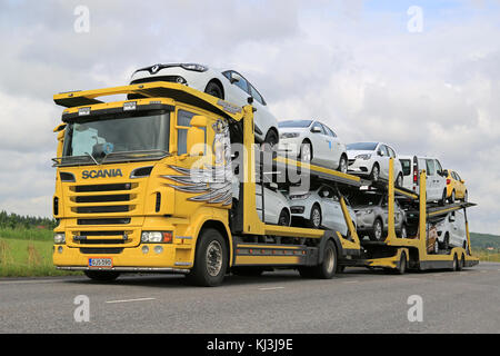 SALO, FINLAND - JULY 26, 2015: Scania R500 car carrier hauls new cars along road. A scrapping scheme for old vehicles - Stock Photo