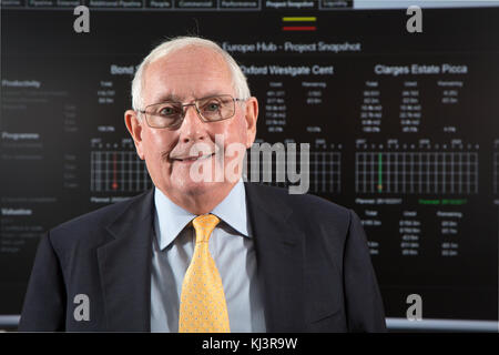 Ray O'Rourke, Chief Executive of construction company Laing O'Rourke. Photographed in front of data projected from - Stock Photo