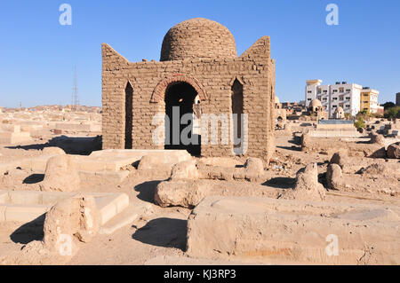 Ancient brick tombs in the Fatimid Cemetery dating back to the 9th century in Aswan, Egypt - Stock Photo