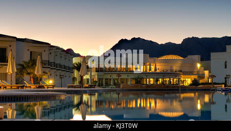 Nuweiba Beach Resort at sunset with the mountains in the background of Sinai, Egypt. - Stock Photo