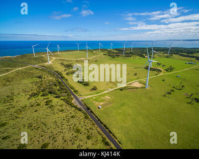 Aerial view of rural road and wind farm in Australia - Stock Photo