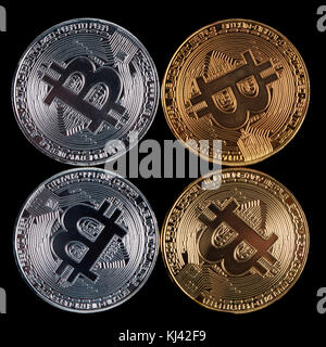 Golden and Silver Bitcoins on black background - top view - Stock Photo