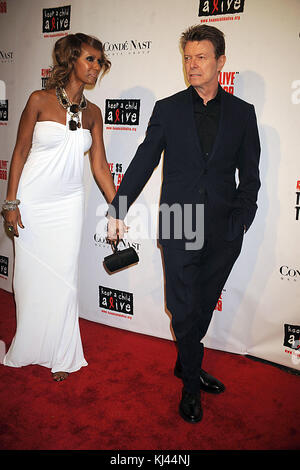 NEW YORK CITY, NY - NOVEMBER 13:  David Bowie and Iman inside Keep A Child Alive's 5th annual Black Ball at Hammerstein - Stock Photo