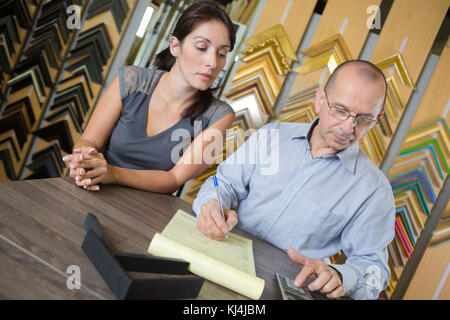 young attractive couple accounting at home - Stock Photo