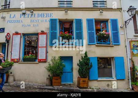 Parisian Pizzeria in Montmare district of Paris, France - Stock Photo