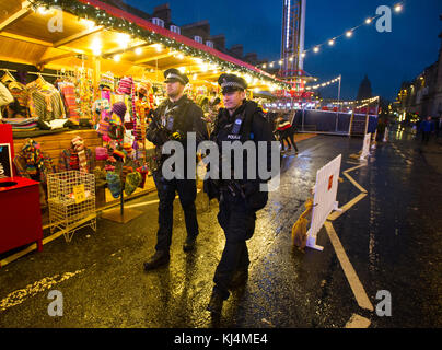 Two armed police officers on patrol in George Street Edinburgh during the Christmas period. - Stock Photo