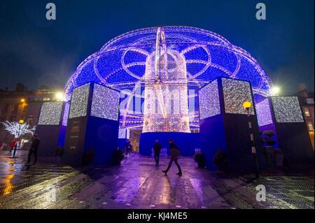 Christmas lights and entertainment  in George Street, Edinburgh - Stock Photo