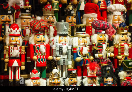 Hand made figures for sale on  a stall at Edinburgh Christmas market. - Stock Photo