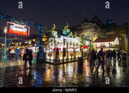 Christmas shoppers outside the Edinburgh Christmas market at the Mound in Edinburgh. - Stock Photo