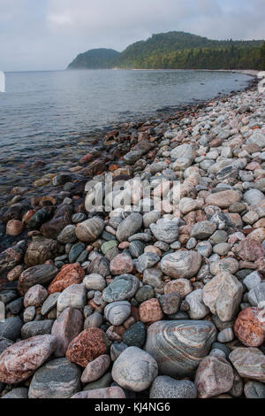 Cobblestone  beach, near Coldwater River, Lake Superior Provincial Park, Ontario, Canada, by Bruce Montagne/Dembinsky - Stock Photo