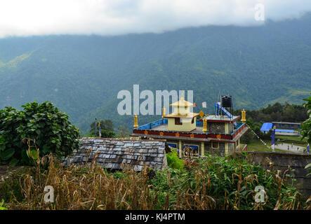 Ghandruk, Nepal - Oct 20, 2017. A Tibetan Buddhist temple on the hill in Ghandruk, Nepal. Ghandruk is a popular - Stock Photo