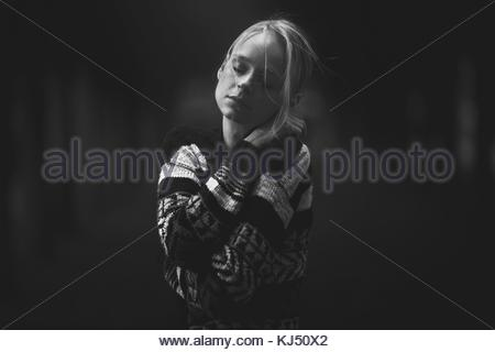 Young woman in knitted sweater - Stock Photo
