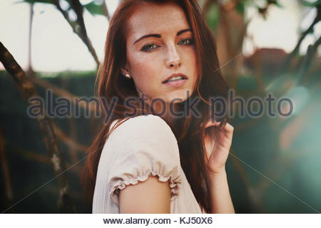 Young woman with brown hair - Stock Photo