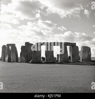 1950s, historical picture of the ancient burial ground of Stonehenge near Salisbury, Wiltshire, England, UK. At - Stock Photo