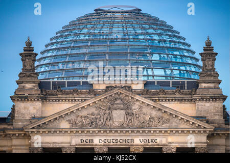 Berlin Reichstag, close-up view of the pediment and glass dome of the Reichstag building in Berlin, Germany. - Stock Photo