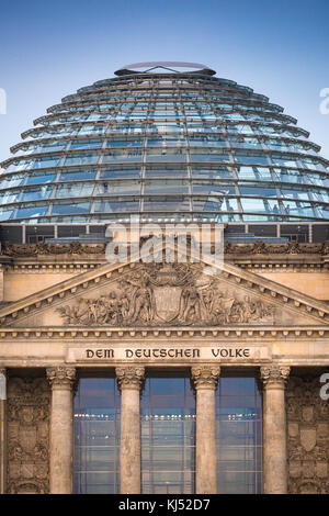 Reichstag Berlin, close-up view of the pediment and glass dome of the Reichstag building in Berlin, Germany. - Stock Photo