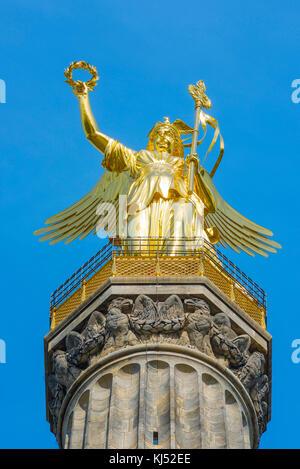 Siegessaule Berlin, the figure of Victory on top of the Siegessaule column in the Tiergarten, Berlin, Germany. - Stock Photo