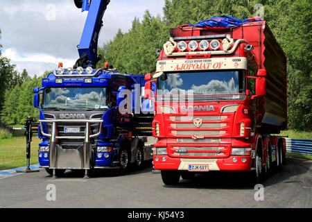 HAMEENLINNA, FINLAND - JULY 11, 2015: Red R560 and blue Scania trucks at Tawastia Truck Weekend 2015. - Stock Photo