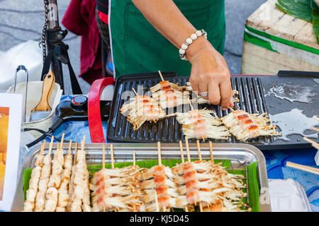 CHIANG MAI, THAILAND - AUGUST 21: Food vendor cooks at the Sunday Market (Walking Street) on August 21, 2016 in - Stock Photo