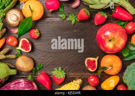 Overhead photo of fresh vegetables and fruits with copy space - Stock Photo