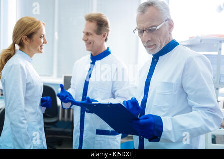 Experienced researchers working in the lab - Stock Photo